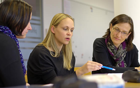 A teacher working with administrators.