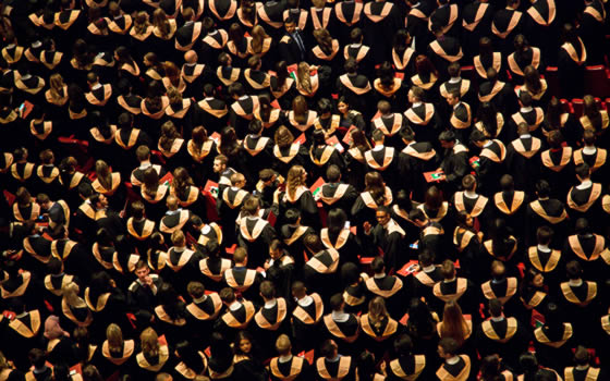 Overhead view of college graduates in cap and gown