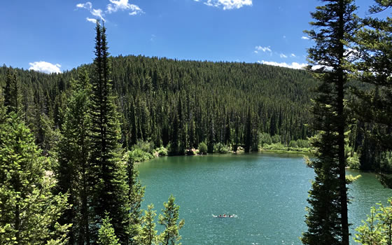 3 revelers swim in packsaddle lake, near Rexburg