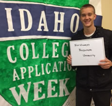 Student holding I applied sign