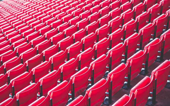 Empty stadium seats await graduation